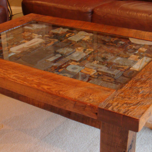 Coffee Table in Antique Reclaimed Pine with Glass Display. Shown with Antique Press Letter Stamps...display your own treasures!