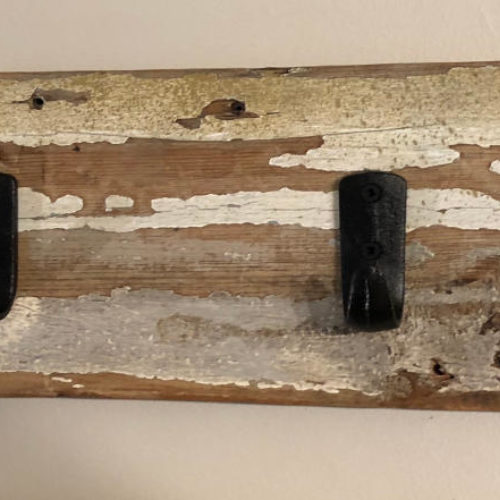 Hookboard with Cast Iron Hooks on Reclaimed Painted Board
