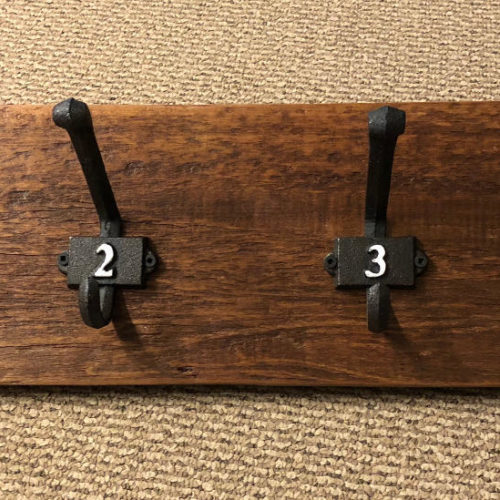 Hookboard with Cast Iron Number Hooks on Reclaimed Board