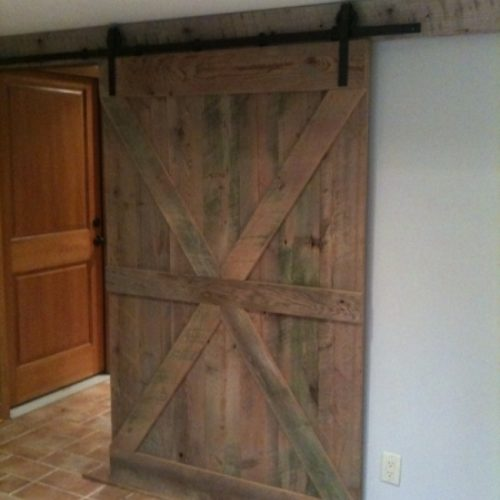 Reclaimed Barn Wood Door with Batten Detailing